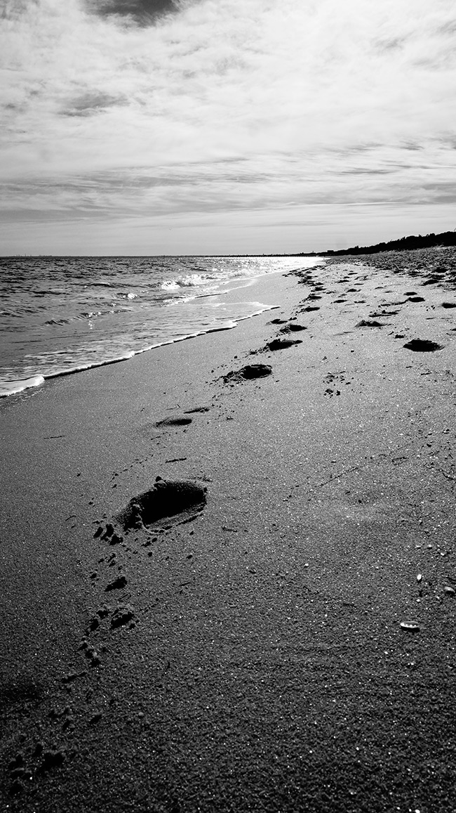 Footsteps in sand at beach